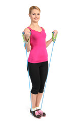 Female biceps exercise using rubber resistance band