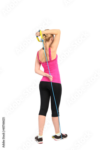 Female triceps extention exercise using rubber resistance band