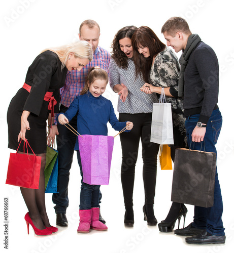 Happy group of shopping people holding bags