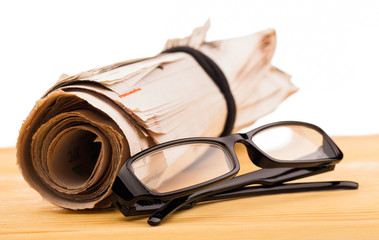 role of newspapers and reading glasses