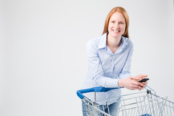 Woman with a Push Cart and a Mobile Phone