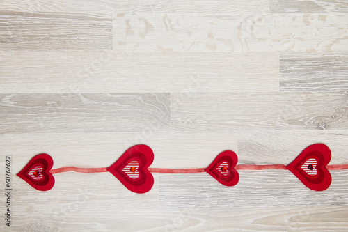 grey wooden background with garland