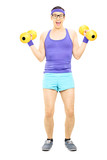 Guy with glasses exercising with dumbbells