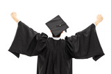 Graduate student in graduation gown with raised hands, rear view