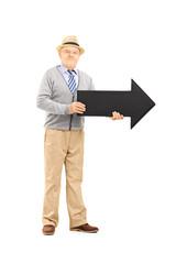 Full length portrait of senior gentleman holding arrow