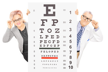Middle aged woman and a male optician behind eyesight test