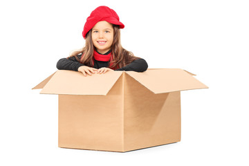 Playful little girl in carton box