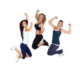 Three young girls jumping isolated