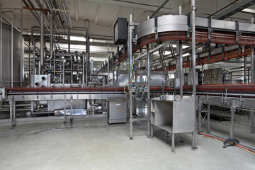 The interior of brewery, conveyor line for the bottling of beer