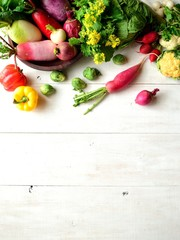Colorful root vegetables with spring vegetables