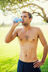 Man drinking water after workout outdoors