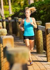 Woman running outside along path