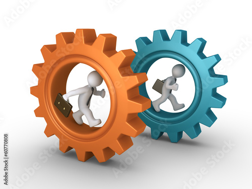Two businessmen running inside cogwheels