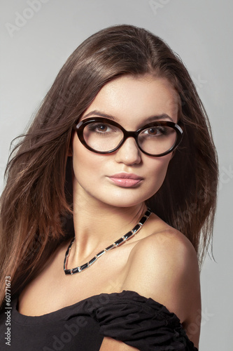Young beautiful woman with long hairs wearing glasses