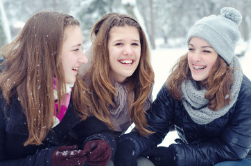 Three teenage girls having fun in the snow