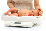 Newborn baby on a weight scale