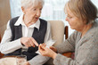 Elderly lady with family or caretaker discussing her medications