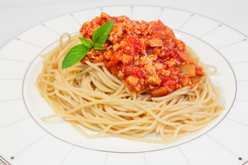 Spaghetti with tomato sauce on a plate.