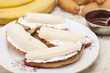 Bananas on toasted white bread with white cream and chocolate.
