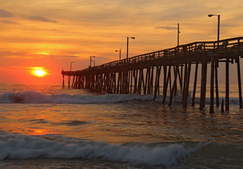 Sunrise by a fishing pier in North Carolina