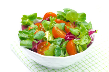 fresh salad and cherry tomatoes in a bowl, isolated