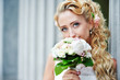 Happy bride with wedding bouquet