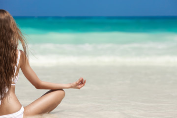 Woman Meditation At Tropical Beach