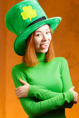 Red hair girl in Saint Patrick's Day party hat