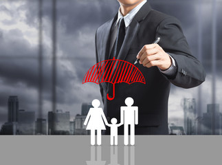 Business man drawing insurance concept