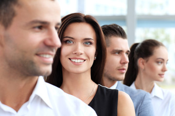Successful happy woman with business group
