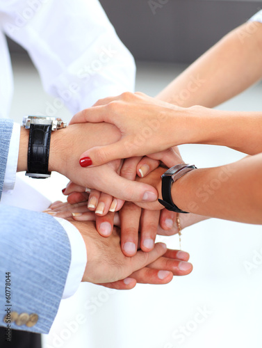 business team putting their hands on top of each other
