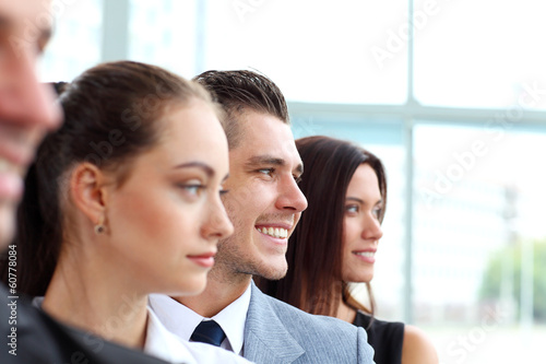 business team standing in a row at office and looking upwards
