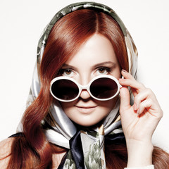 Portrait of beautiful young woman in round fashion sunglasses.