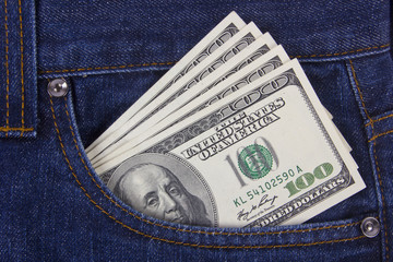 Many U.S. dollars in jeans pocket