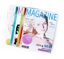 Pile of magazines on white background