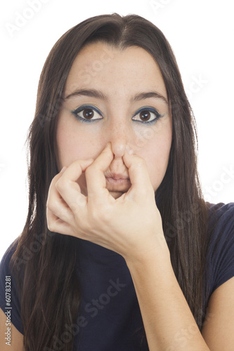 Young girl smelling something stinks
