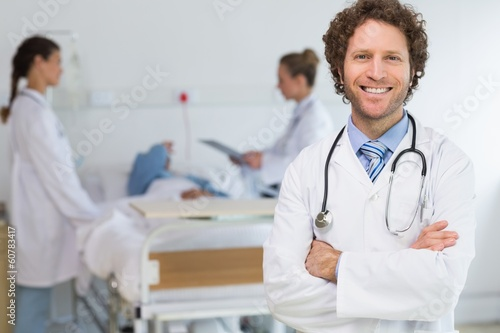 Portrait of doctor standing arms crossed