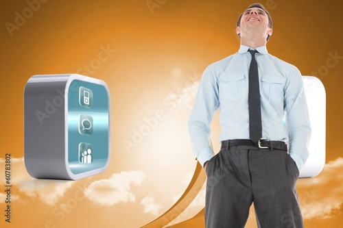 Composite image of happy businessman standing with hands