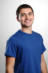 Smiling boy smiling wearing blue t-shirt
