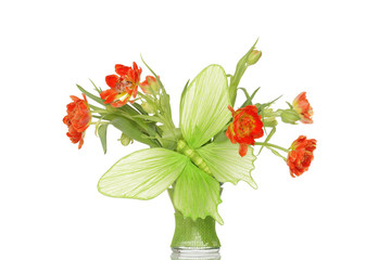 Big green paper butterfly and orange tulips in glass vase