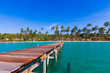Wooden pathway.  Tropical Resort. boardwalk on beach