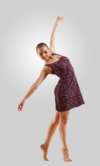 Girl in color dress dancing