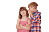 boy whispering a secret little girl on white