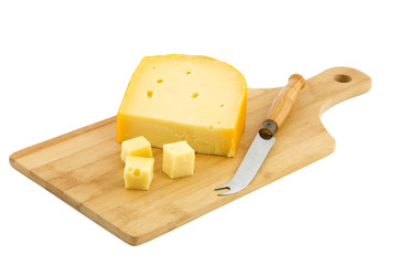 cutting board and piece of Dutch cheese
