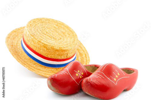 orange reed hat and red wooden shoes