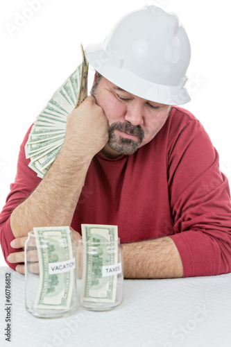 Construction worker splitting money