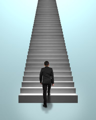 Businessman climbing on concrete stairs