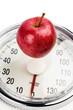 apple lies on a balance