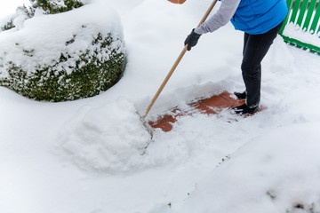 shoveling snow woman while