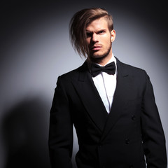 dramatic elegant man in tuxedo and bow tie